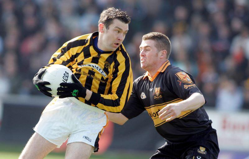 Dr.Crokes's Keith Mahon tackles Crossmaglen's Oisin McConville, AIB Club Football Final Replay 2007 ©INPHO/Tom Honan