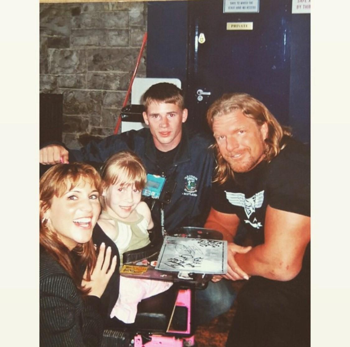 Joanne (8), Stephanie McMahon, Danny O'Riordan and WWE wrestler Triple H © Joanne O'Riordan