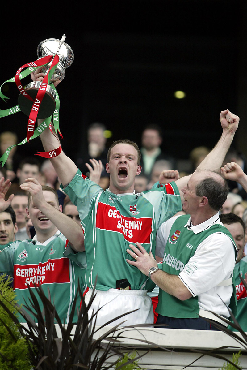 David Brady lifts the cup after Ballina Stephenites beat Portlaoise