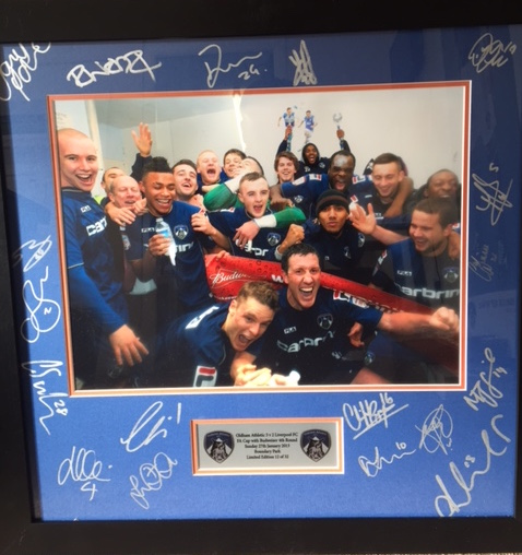 Limited edition framed photo of the 2013 FA Cup 4th round dressing room celebrations signed by the entire squad