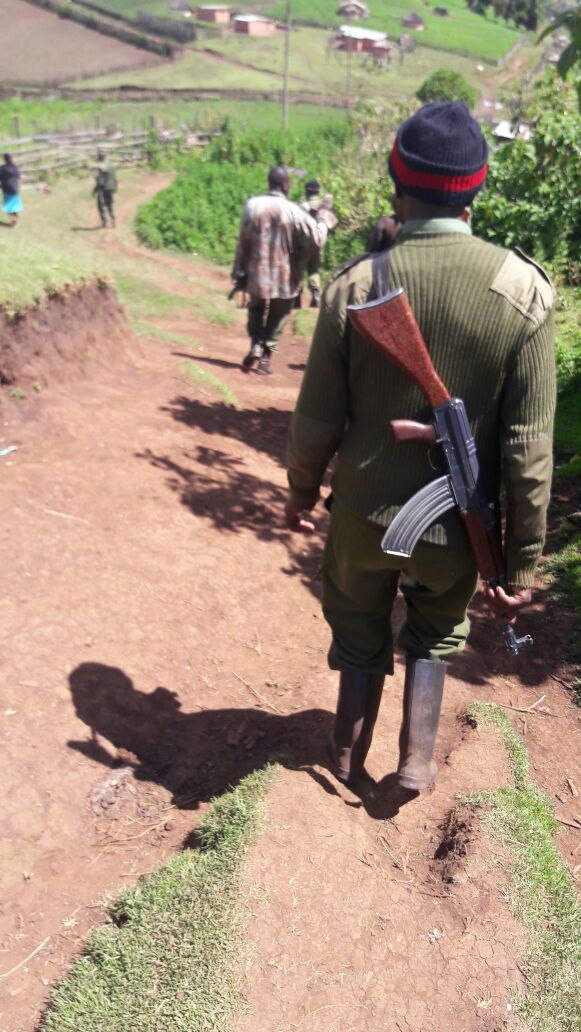 KFS guards around the forest boundaries carrying guns and  binoculars.