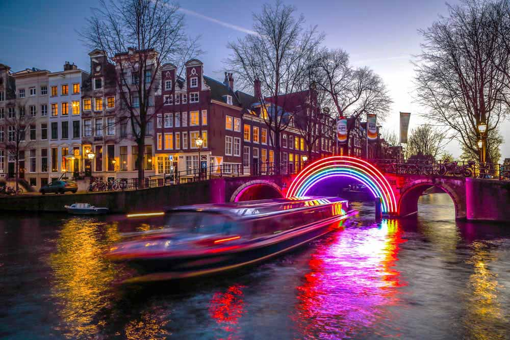 The canals light up for dinner cruises in Europe