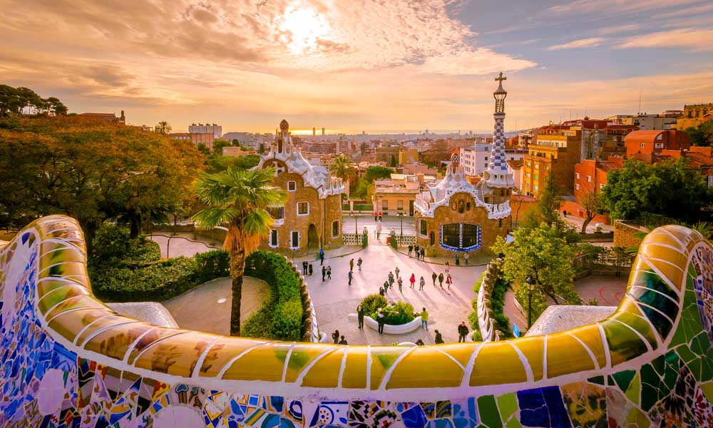 Park Guell, Gaudí's sprawling architectural wonder, at sunset.