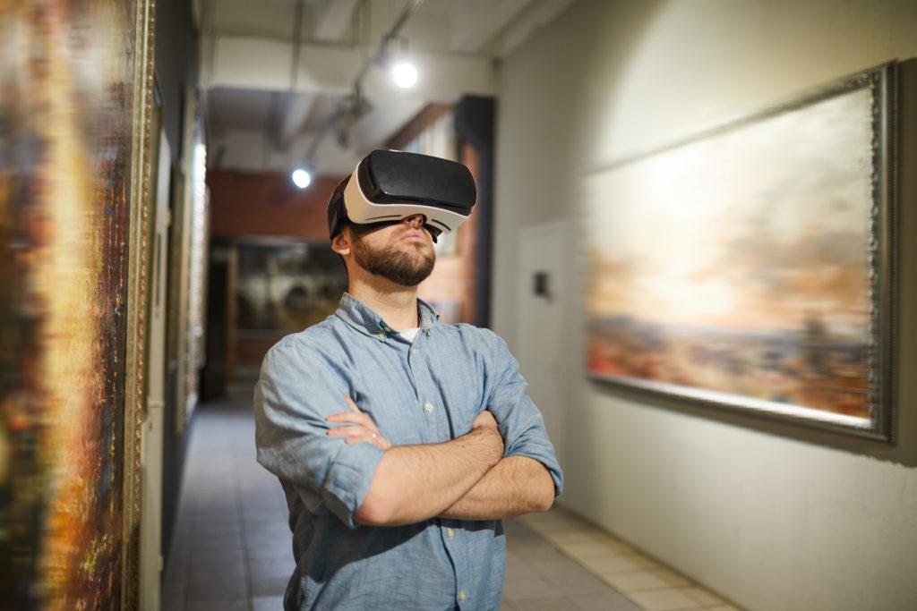 Man wearing VR headset in art galllery