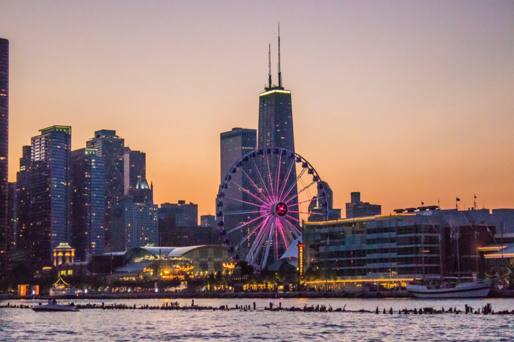 Sunset at the Chicago Navy Pier with skyscrapers behind