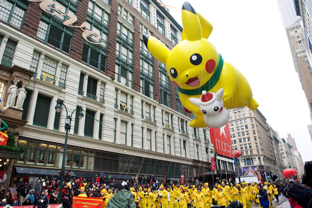 A giant Pikachu balloon floats outside Macy's New York store during the Thanksgiving Day parade