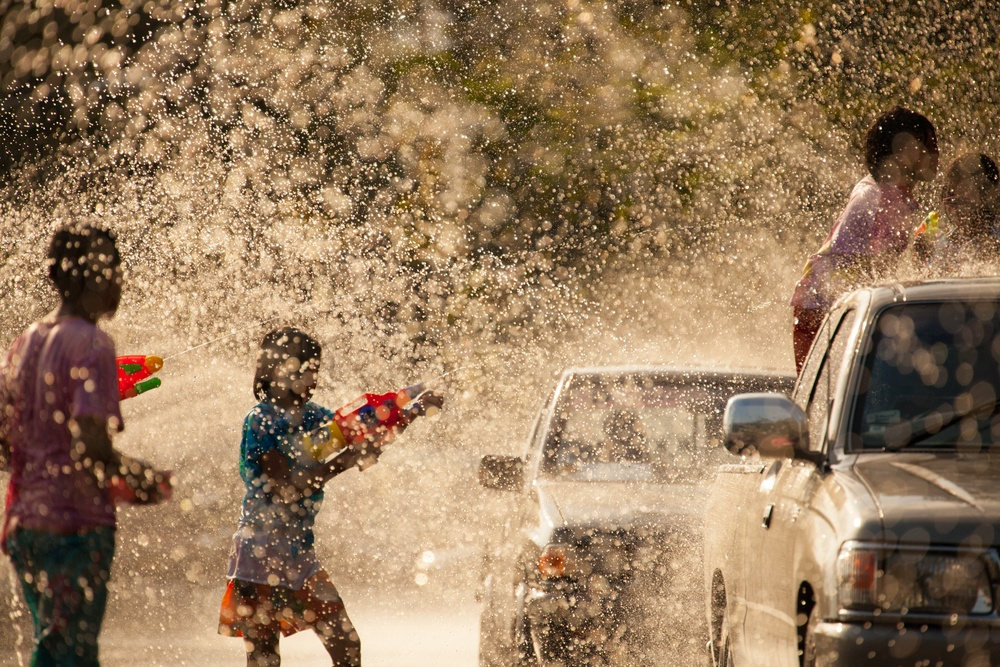 Children playing with water during the Songkran festival in Thailand