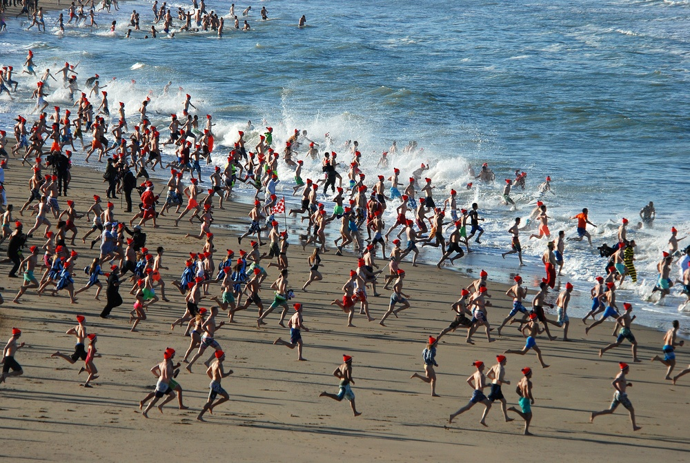 Dutch people running into the water at Scheveningen beach for the traditional new year's dive