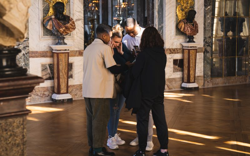 A group of friends in the Peace Room at the Palace of Versailles
