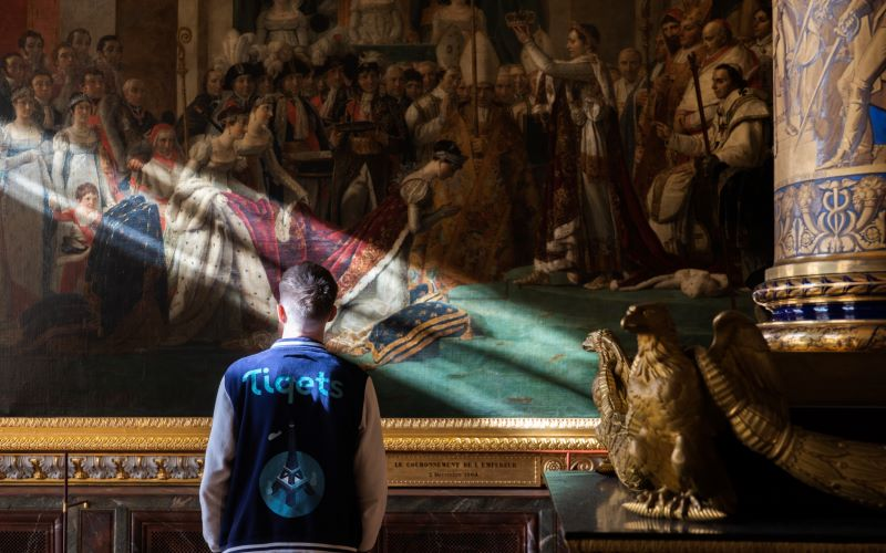 Man stands in the Coronation Room of the Palace of Versailles