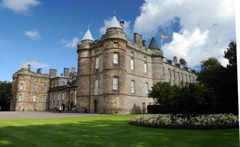 The exterior of Palace of Holyroodhouse with blue skies in the background