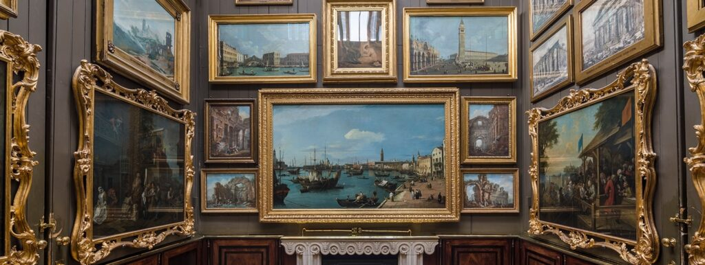 A large number of pictures hangs on the walls. Canaletto and Hogarth paintings are visible.
