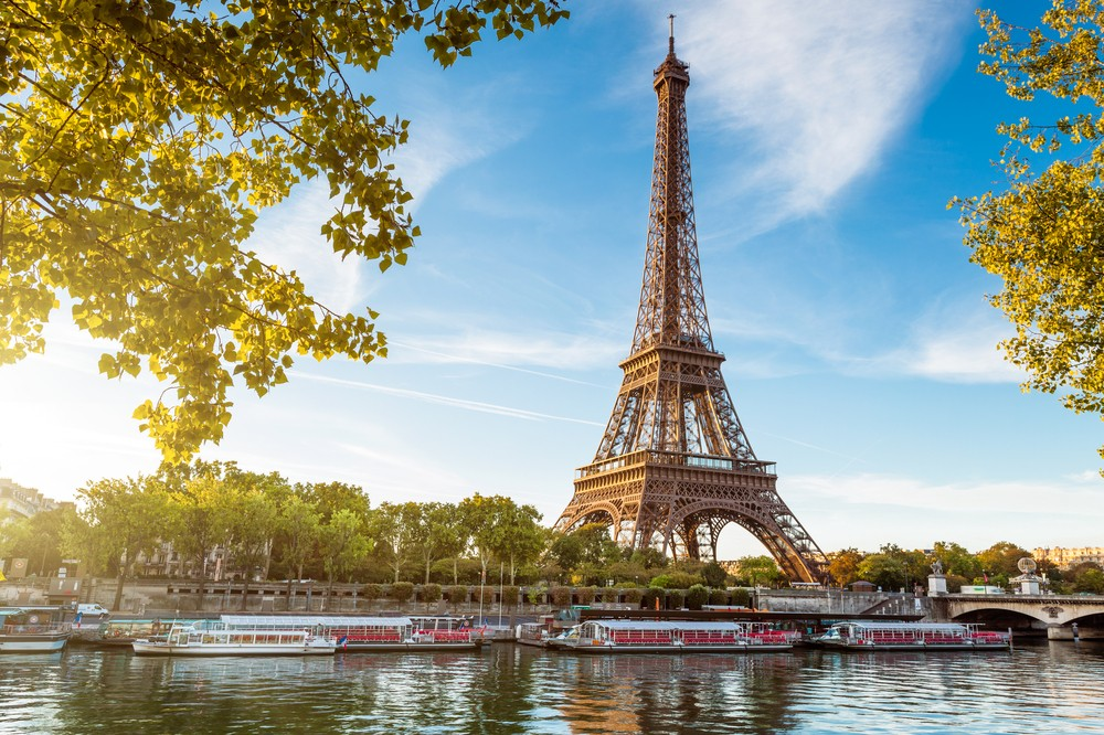 The Eiffel Tower on a sunny day in Paris.