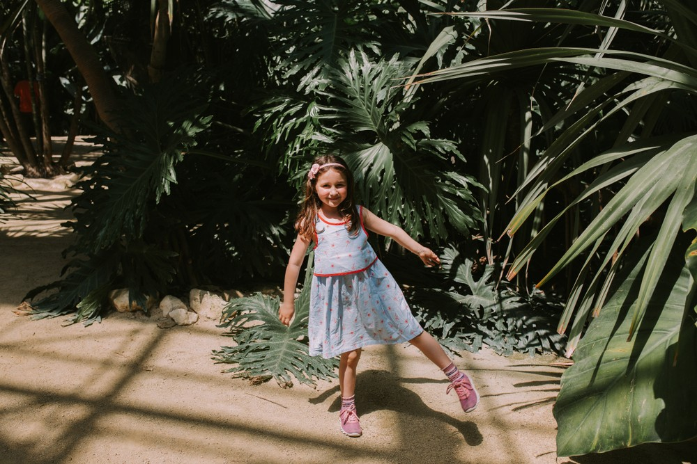 A girl smiling for the camera at Terra Botanica.