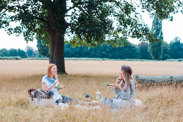 Two women having a picnic in a park
