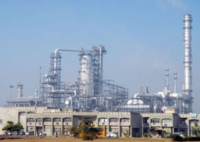 Refinery in India with blue sky and metal pipes in the background