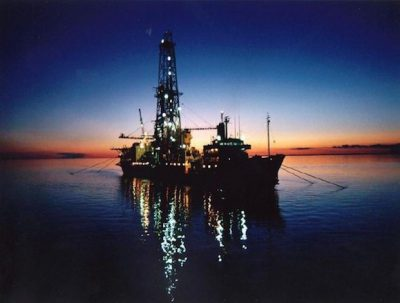 oil terminal in indoenesia with sunset in the background