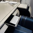 Remote controlled glossy curved desk with mini bar