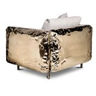 Hammered crushed brass luxury armchair with crinkled upholstery