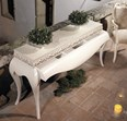 Cream console table with 1 drawer and cream carving