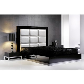 Tall padded headboard and black gloss bedstead