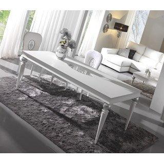 Glossy white dining table with silver leaf carving