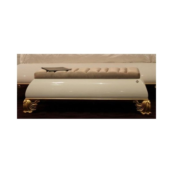 Glossy bench with gold leaf carved feet