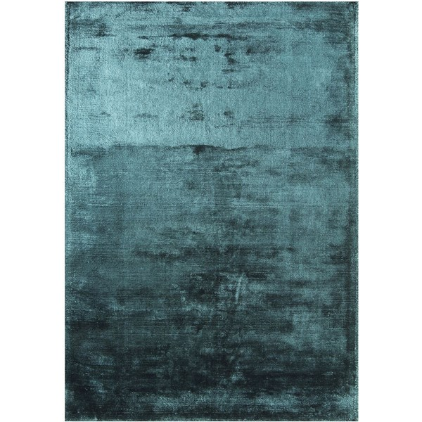 Luxury hand woven light reflecting teal rug