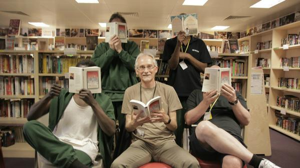 Large hpm thameside prison reading group with volunteer graham reading honour