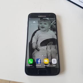 Sælger min Samsung Galaxy s7, som er fr - Nykøbing M - Sælger min Samsung Galaxy s7, som er fra den 11/7-2016, da jeg er gået over til iPhone igen. Den fejler intet - ingen ridser da den altid harr haft cover på samt panzer glas. Alt medfølger samt kvittering Bud modtages.. - Nykøbing M