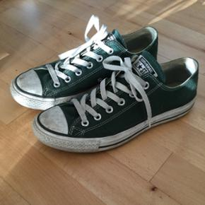 Converse all Star sneakers i mørkegrøn - Århus - Converse all Star sneakers i mørkegrøn str. 40. Det eneste tegn på slid er vist på billede 2, ellers er standen rigtig god. Byd gerne - Århus