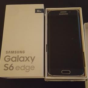 Samsung Galaxy s6 edge 32gb sort Virker  - Esbjerg - Samsung Galaxy s6 edge 32gb sort Virker som den skal. Fra sommeren 2015. Oplader medfølger original æske. Og ubrugte høretelefoner. Den har fået et slag på skærmen ses på billedet. Men den virker stadig som den skal. - Esbjerg