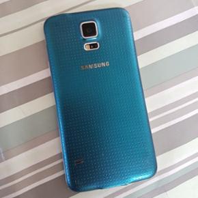 Samsung Galaxy S5. Blå med screenprotec - Hjørring - Samsung Galaxy S5. Blå med screenprotector. Brugt men fin stand. - Hjørring