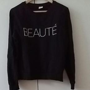 Sweatshirt fra GinaTricot str. L. Sort m - Aalborg  - Sweatshirt fra GinaTricot str. L. Sort med hvid print. Brugt få gange. - Aalborg