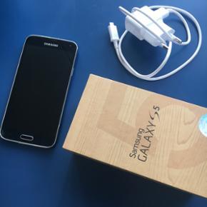 Samsung Galaxy S5 Købt D. 21/2-15 hvilk - Aalborg  - Samsung Galaxy S5 Købt D. 21/2-15 hvilket vil sige der ikke længere er garanti på den. Den er i fin stand uden synlige ridser på skærmen, men med lidt skræmmer på siden her og der. - Aalborg
