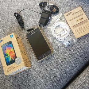 """Samsung Galaxy Trend 2 - Super fin mobil - Randers - Samsung Galaxy Trend 2 - Super fin mobil sælges. Den har 4"""" skærm, 5MP kamera med blitz. Der medfølger headset der aldrig er brugt, original oplader samt overførsels stik, kasse og diverse papirer. Telefonen er nulstillet så den er lige til - Randers"""