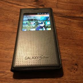 Samsung Galaxy s5 mini, med aktivt cover - Frederikshavn - Samsung Galaxy s5 mini, med aktivt cover i pæn stand. Bagcoveret er blevet væk, så derfor følger det aktive cover med! Byd - Frederikshavn
