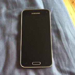Samsung Galaxy s5 mini virker perfekt me - København - Samsung Galaxy s5 mini virker perfekt medfølger en smule defekt oplader (den virker også men er ikke køn) - København