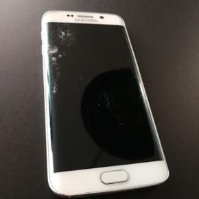Samsung galaxy s6 edge. Som billederne v - Aalborg  - Samsung galaxy s6 edge. Som billederne viser er skærmen ødelagt dog virker alt touch og ellers kører telefonen perfekt. Den har for 6 måneder siden fået nyt batteri, plus nyt kamera og bagskærm. Oplader medfølger. - Aalborg