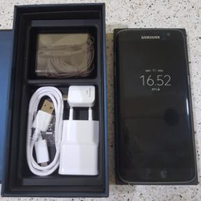 Samsung Galaxy s7 edge sort farve. Alle  - Odense - Samsung Galaxy s7 edge sort farve. Alle knapper og funktioner virker upåklageligt. Den er i super flot stand. Ingen ridser på skærmen eller bagsuden. Der følger alt tilbehør med. Oplader USB adapter og headsæt som aldrig er brugt. Sælges b - Odense