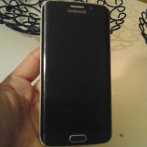 Samsung Galaxy s6 edge sælges. Meget p? - Hjørring - Samsung Galaxy s6 edge sælges. Meget pæn velholdt og i næsten ny stand uden ridser og virker perfekt. Den holder batteri som da den var nykøbt. Den sælges med alt tilbehør og kvitering haves. Jeg sender gerne hvis modtager betaler fragt  - Hjørring
