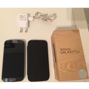 """Samsung Galaxy s4, 5"""", 16 GB, 13mp kamer - Horsens - Samsung Galaxy s4, 5"""", 16 GB, 13mp kamera. Med cover og original boks. Lidt slidt, som det kan ses på billederne. Men den fungerer, som den skal. Coveret er dog aldrig blevet brugt. - Horsens"""