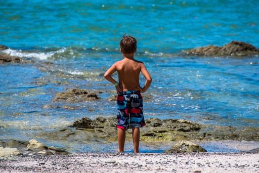 Boy in the sea, Costa Rica