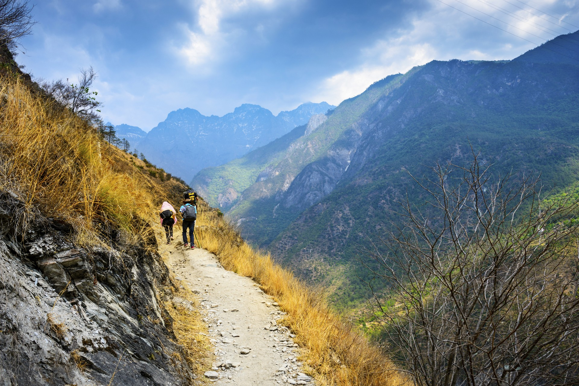 Hikers trekking along Tiger Leaping Gorge in China