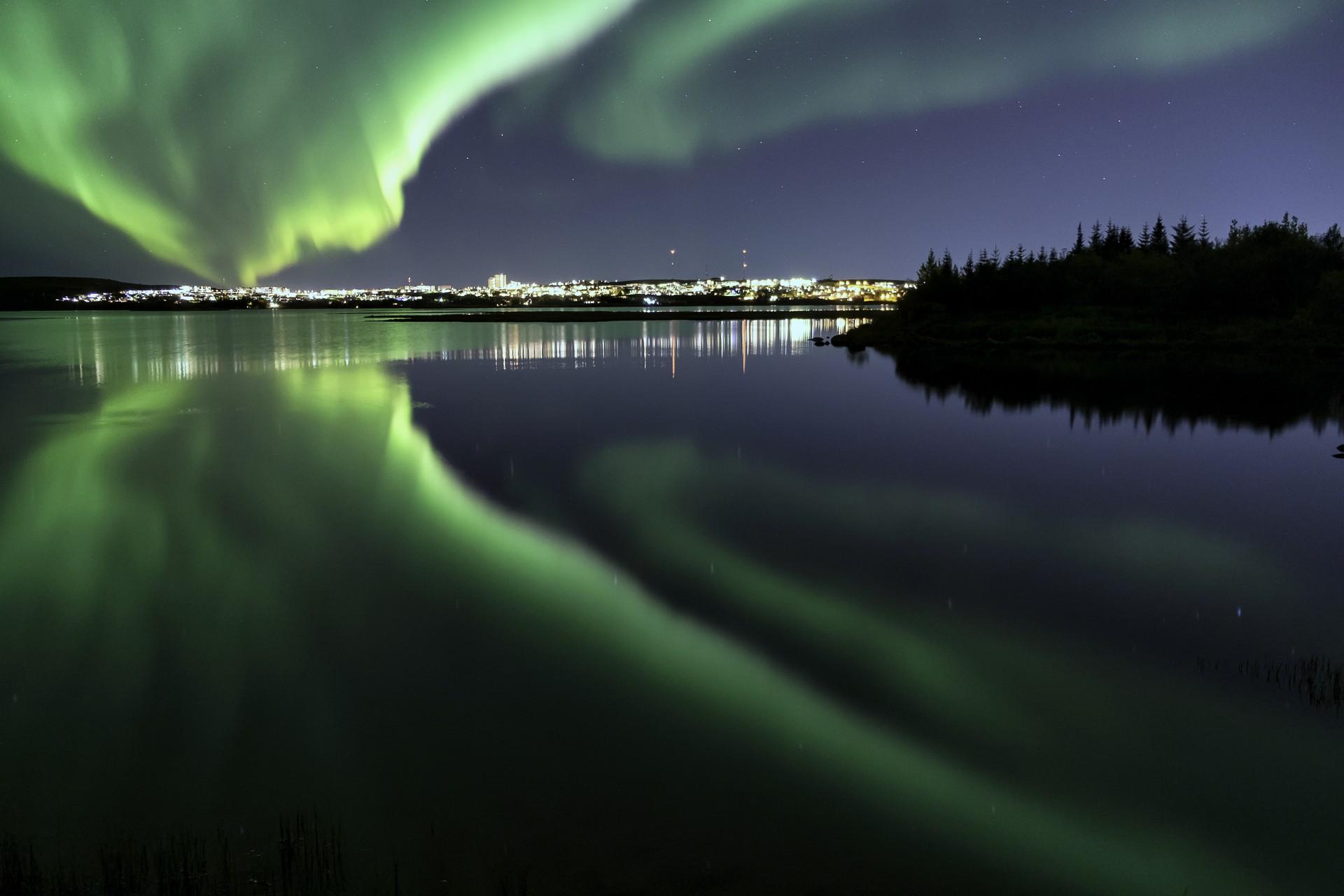 Northern lights over Eillidavatn, near Reykjavik, Iceland