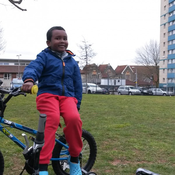 Image: A happy resident with his recently fixed bike