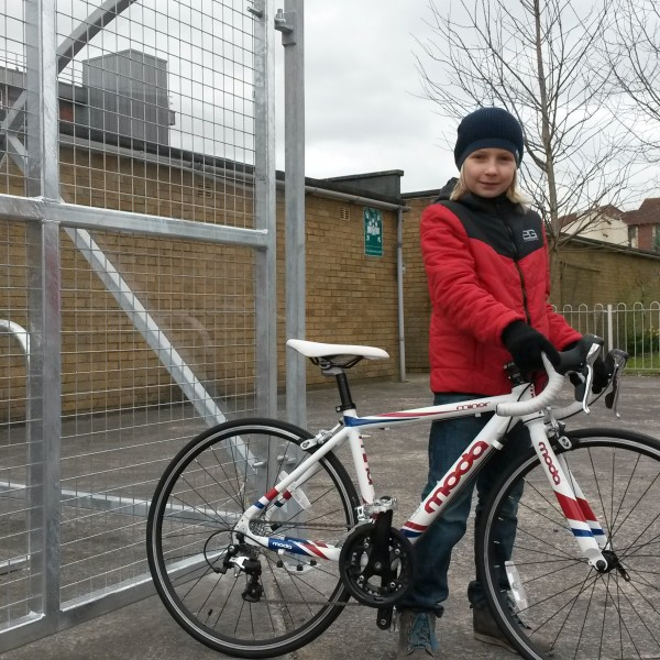 Image: A young resident outside the new cycle shelter