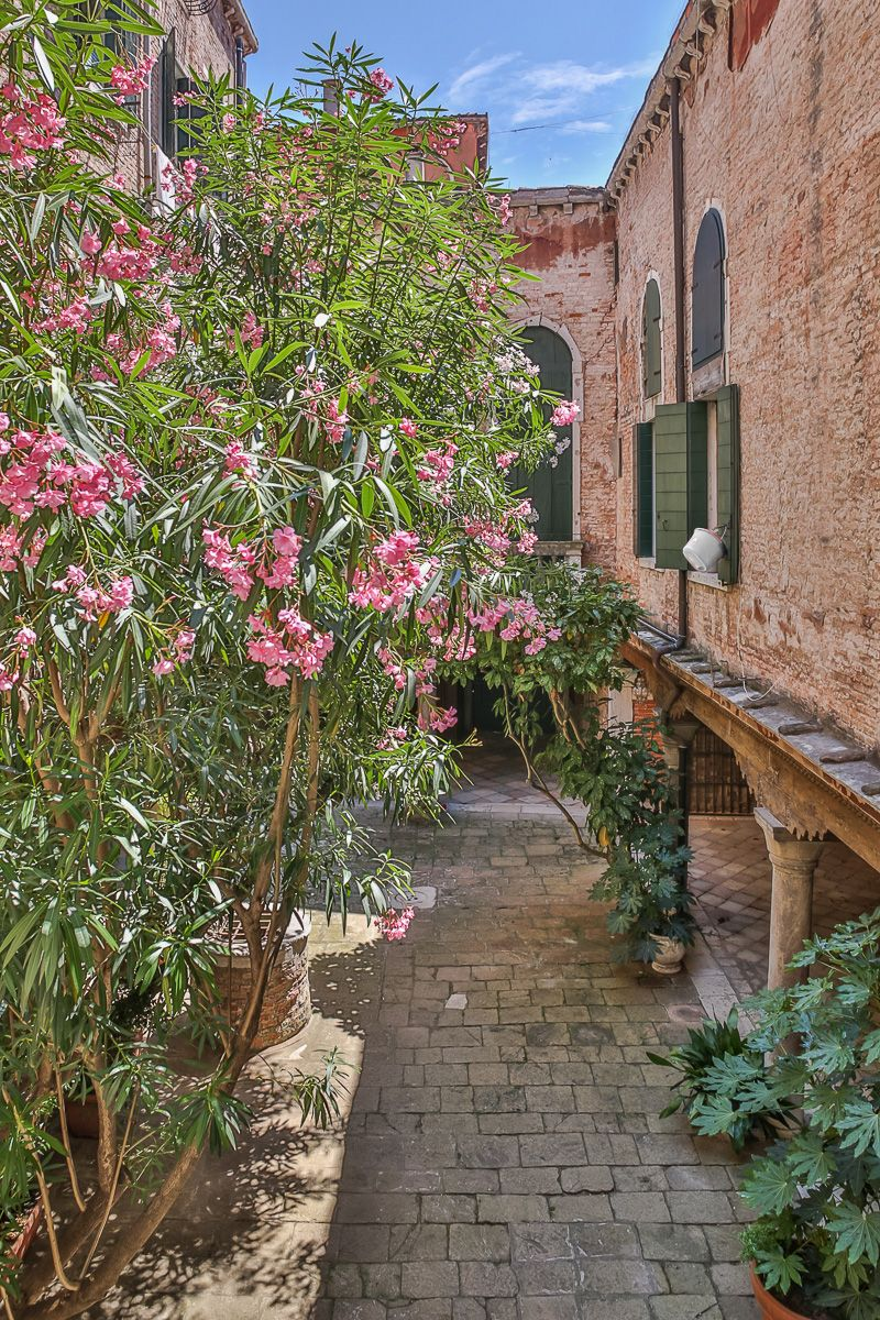 view from the balcony of the sitting room on the entrance courtyard