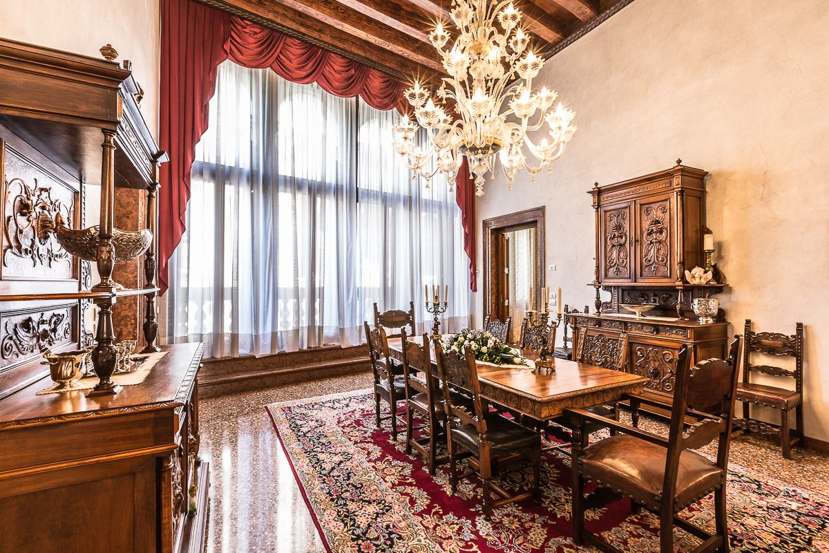 while on the other side of the room can be found a large dining table