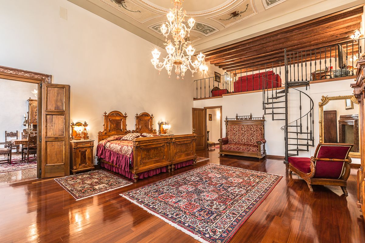 huge master bedroom with media room on the mezzanine leve